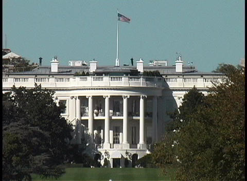 Trees surround the White House in Washington DC Stock Video Footage
