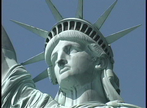 The Statue of Liberty stands with her crowned and solemn... Stock Video Footage