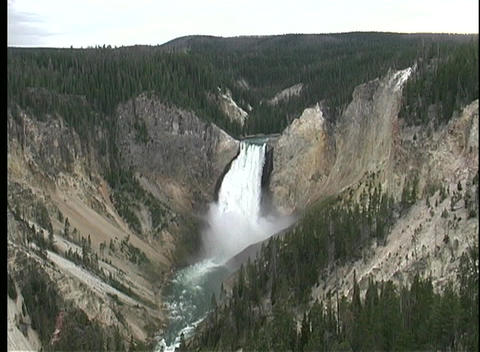 A beautiful waterfall cascades into a steep valley in Yellowstone National Park Footage