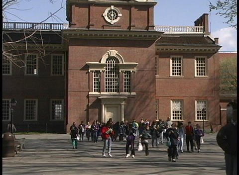 Tourists walk through the courtyard in front of... Stock Video Footage