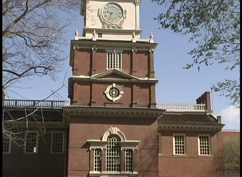 Tourists walk through the courtyard in front of Independence Hall in Philadelphia Footage