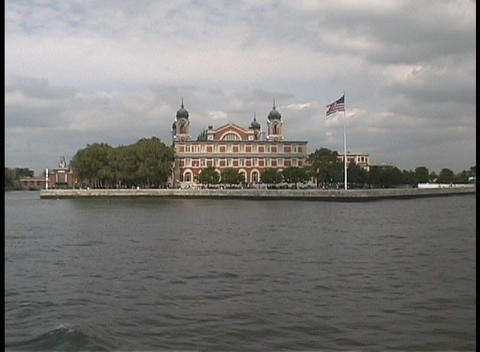 The American Flag on Ellis Island blows in the wind Stock Video Footage