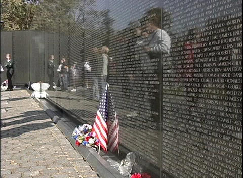 Tourists visit The National Vietnam Veterans Memorial in Washington, DC Footage