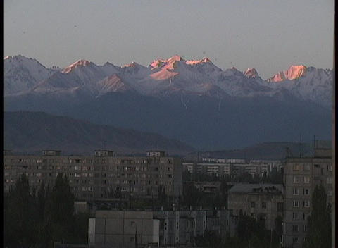 The sun shines on the snowy peaks of the Tian Shan... Stock Video Footage