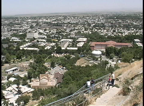 Tourists walk down a trail to view the whole city of Osh,... Stock Video Footage