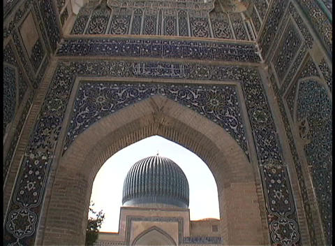 An archway frames the dome of a historic mosque in Samarkand, Uzbekistan Footage