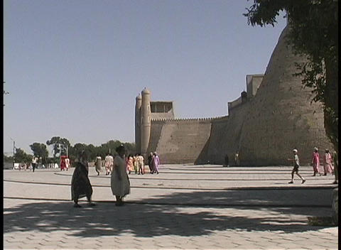 People walk outside The Ark of Emir's Palace in the... Stock Video Footage