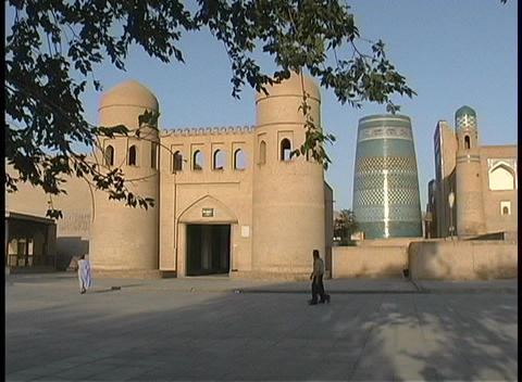 People walk in front of the entrance to the walled city... Stock Video Footage