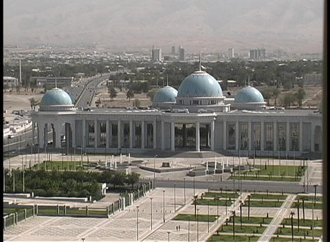 Traffic flows in front of the official city buildings of Ashgabat, Turkmenistan Footage