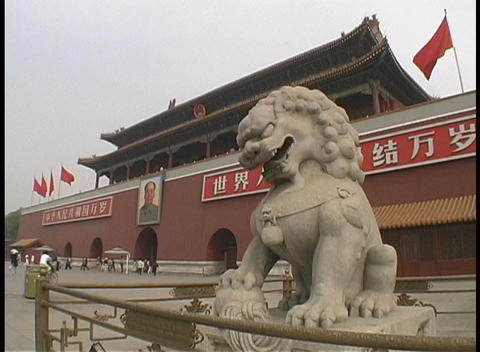 An Imperial lion statue guards the Tiananmen Gate in China Stock Video Footage