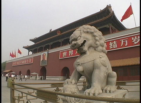 An Imperial lion statue guards the Tiananmen Gate in China Footage