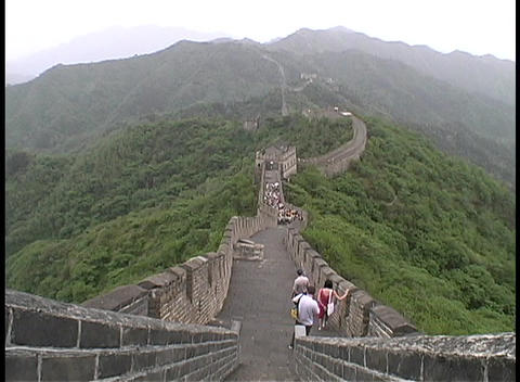 Tourists walk on top of the Great Wall of China Footage