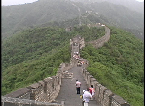 Tourists walk on top of the Great Wall of China Stock Video Footage