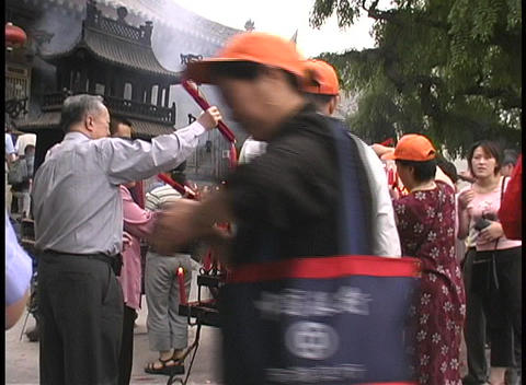 Men and women light candles outside the Big Goose Pagoda... Stock Video Footage