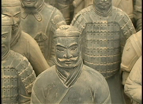 The unearthed terracotta figures commissioned by Emperor Qin Shi Huang rest side by side Footage