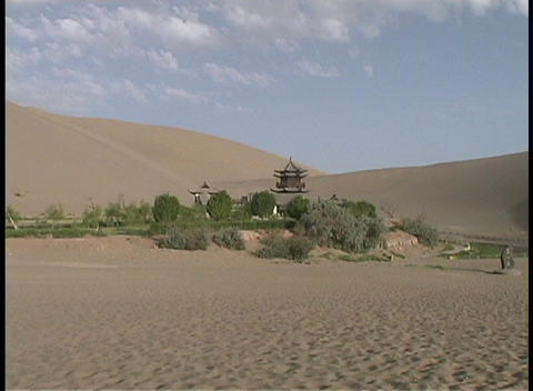 The Crescent Moon pagoda adorns the desert in Dunhuang, China Footage
