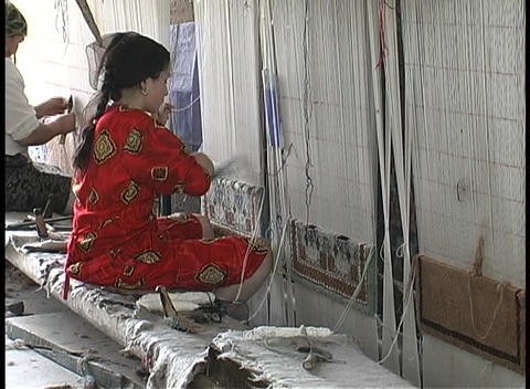 A woman works on a panel in a silk factory in Hotan, China Footage