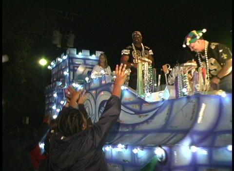 A look at a Mardi Gras float and crowds at night Footage