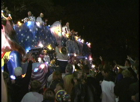 The crowds wave at the colorful characters on a Mardi... Stock Video Footage