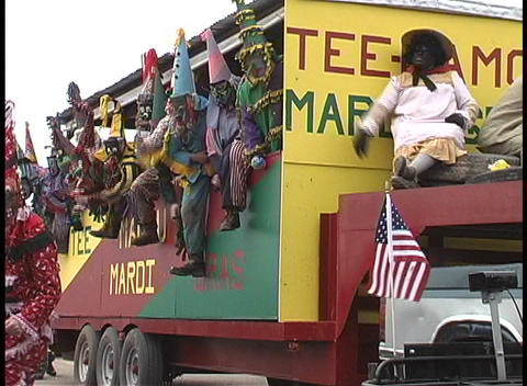 A group of very colorfully costumed men ride together on... Stock Video Footage