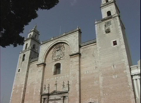 The camera pans up the facade of the Catholic church in Merida, Mexico Footage