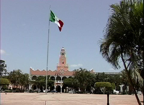 The red, white and green flag of Mexico waves in the breeze in front of the Merida City Hall, Merida Footage