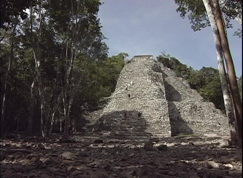 Tourists continue to climb the ancient Mayan ruins in... Stock Video Footage