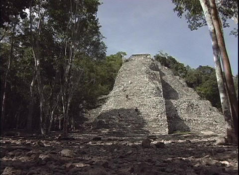 Tourists continue to climb the ancient Mayan ruins in Tulum, Mexico Footage