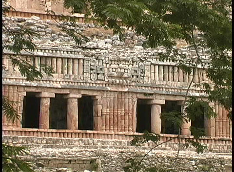 The facade of an ancient Mayan ruin shows the intricate... Stock Video Footage