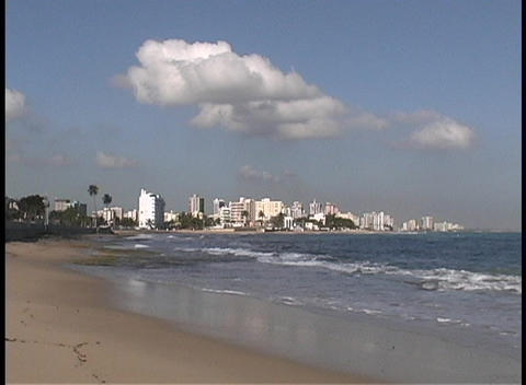 Waves break along a sandy beach in front of the San Juan... Stock Video Footage