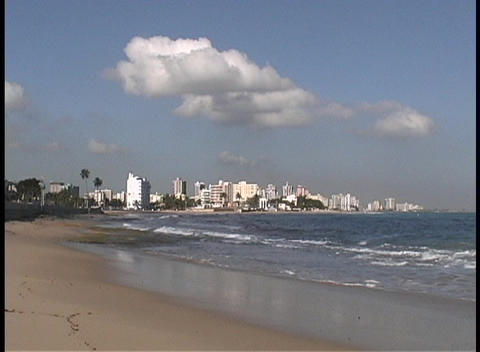 Waves break along a sandy beach in front of the San Juan... Stock Video Footage