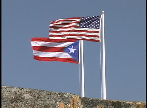 The United States and Puerto Rico flags fly side by side Footage
