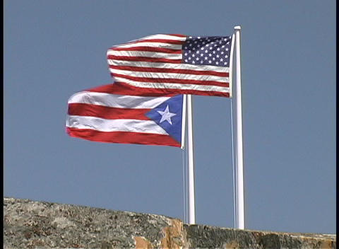 The United States and Puerto Rico flags fly side by side Stock Video Footage
