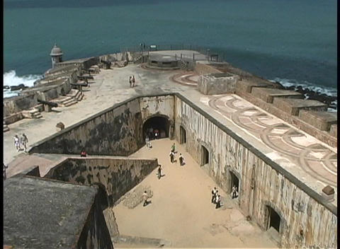 Seen from above, people appear very small as they walk in the courtyard of the Castillo San Felipe d Footage