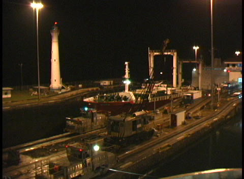 A ship moves through the Panama Canal at night Stock Video Footage