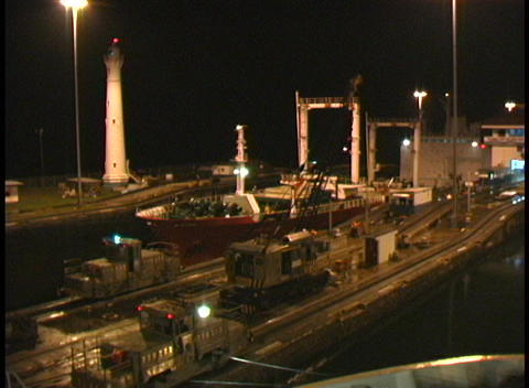 A ship moves through the Panama Canal at night Footage
