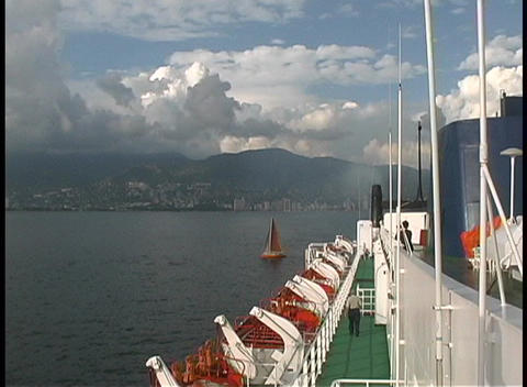 From the deck of a cruise ship, clouds and mist are seen filling the harbor in Acapulco, Mexico Footage