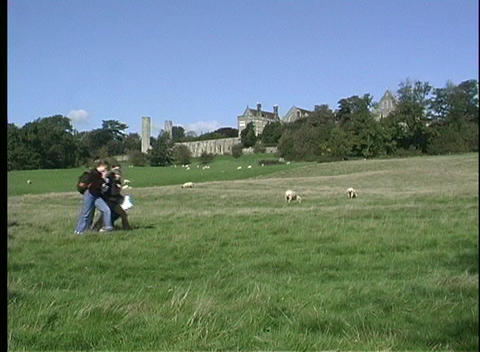 School children walk home over the gentle slopes of the... Stock Video Footage