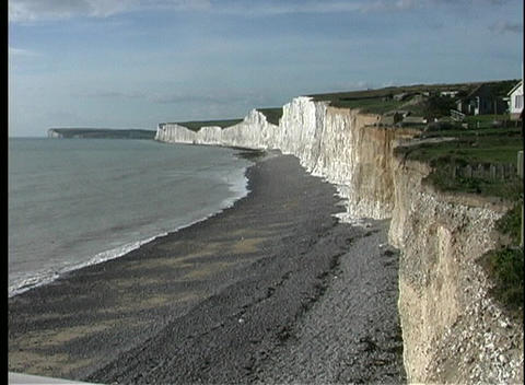 Gentle waves break on the beach in front of the White Cliffs of Dover Footage
