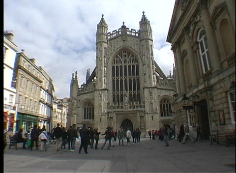Many people walk in the courtyard of an old English church Stock Video Footage