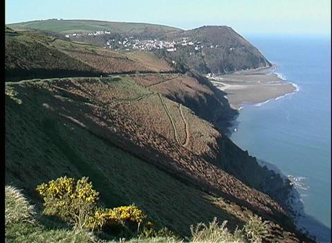 High cliffs mark the rugged coastline of Scotland Stock Video Footage