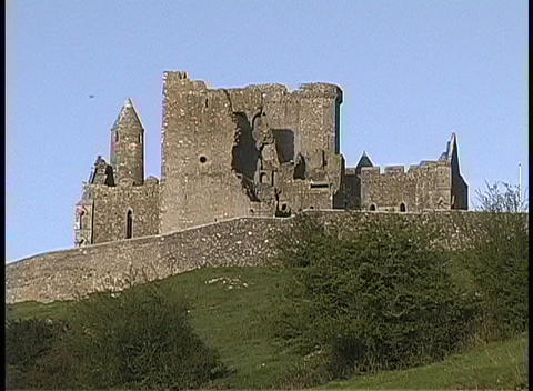 A worms-eye view of the Rock of Cashel ruins on a green... Stock Video Footage