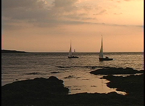 Sailboats glide gently across the water near Roses Point,... Stock Video Footage
