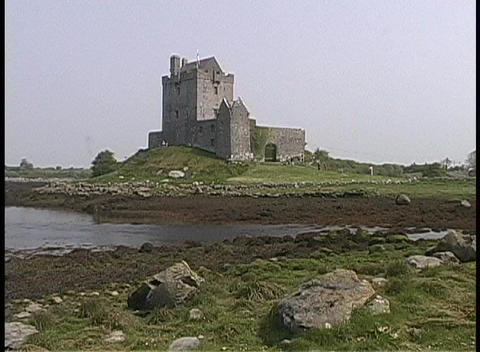 Dunguaire Castle adorns the shoreline in Ireland Stock Video Footage