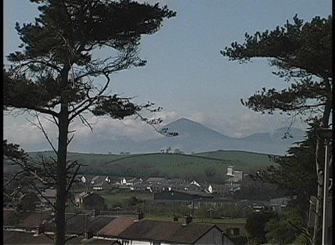 Trees tower over Cushendall Ireland Stock Video Footage