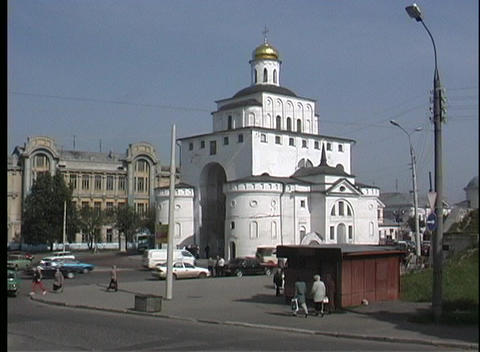 A pan view of traffic and pedestrians near the Vladimir Church in Russia Footage