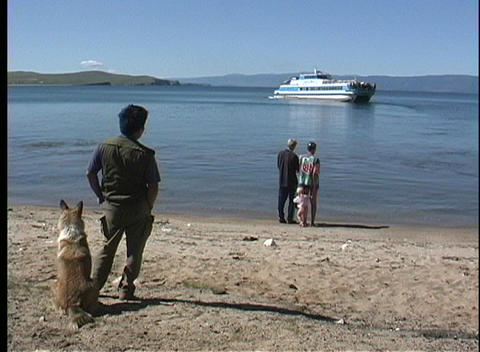 Villagers wait for the ferry along the shore of Lake Baikal in Russia Footage