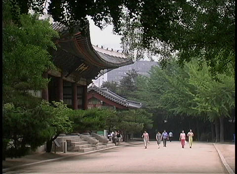 Pedestrians stroll near the Doeksugnung Palace in Seoul,... Stock Video Footage