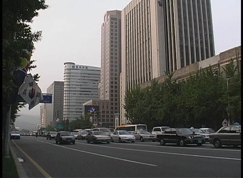 Traffic travels through the busy streets in downtown... Stock Video Footage