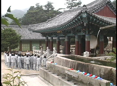 A group of monks listen to the teaches of their teacher Stock Video Footage